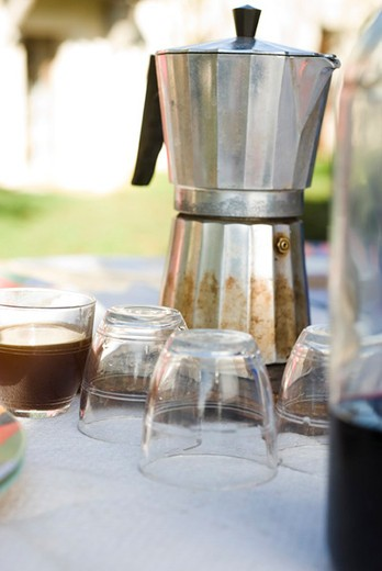 Stock Photo: 4277-2720 Espresso maker and glasses on outdoor table