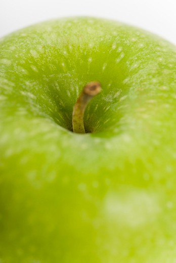 Green apple, close-up of stem : Stock Photo