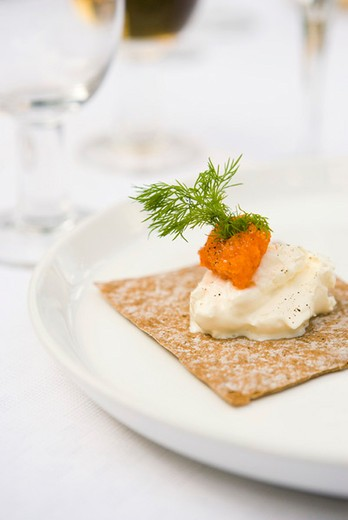 Crisp bread topped with salmon roe and sour cream : Stock Photo