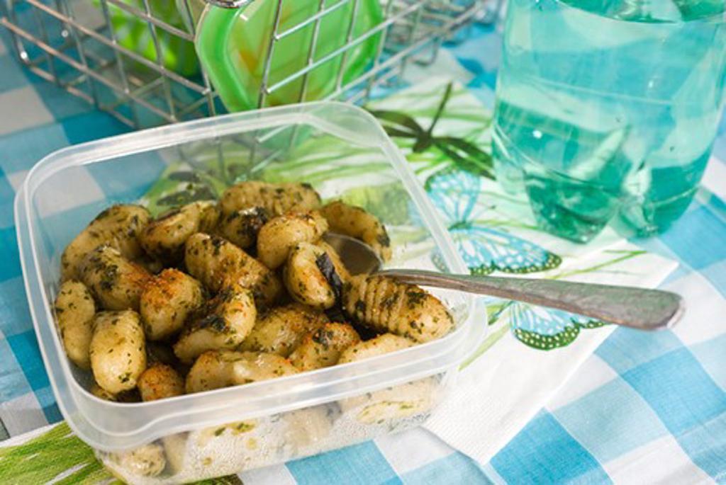 Gnocchi with pesto and espelette pepper : Stock Photo