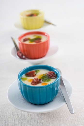 Stock Photo: 4277-3300 Cream of potatoe soup with chorizo and parsley pesto