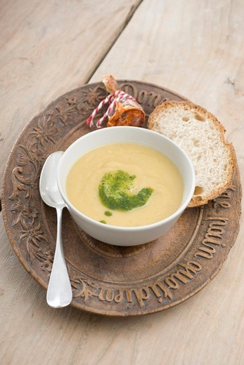 Cream of potatoe soup with chorizo and parsley pesto : Stock Photo