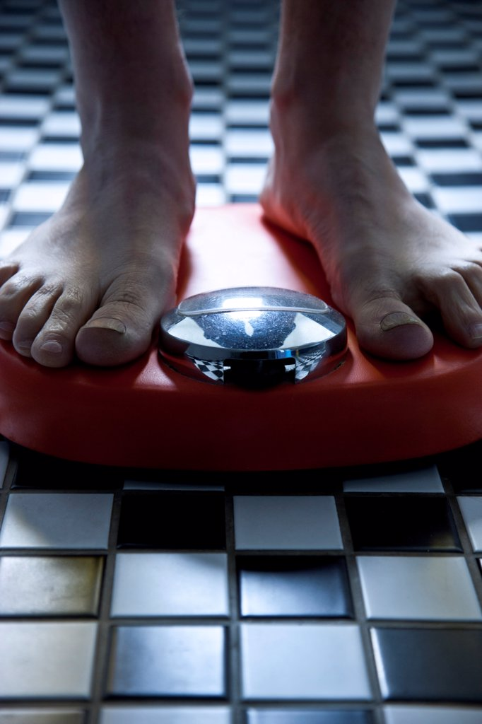 Close up of Feet on Weighing Scale : Stock Photo