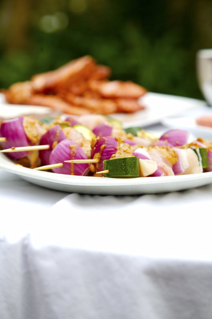 Close up of barbeque platter of food on garden table : Stock Photo