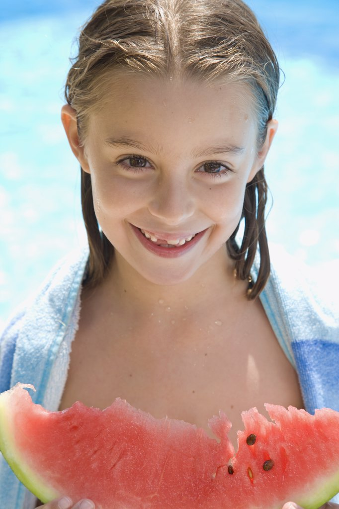 Smiling young girl holding water melon : Stock Photo