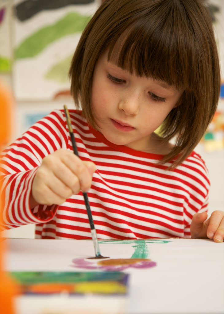 Stock Photo: 4278-1640 Portrait of a girl painting with watercolor