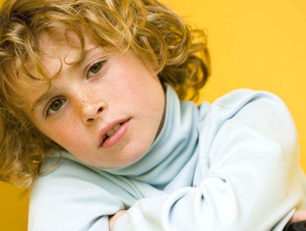 Close up of boy with curly hair : Stock Photo