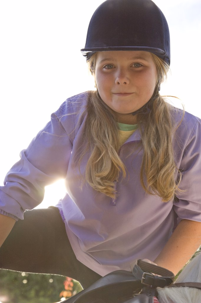 Stock Photo: 4278-4288 Young girl dismounting a horse