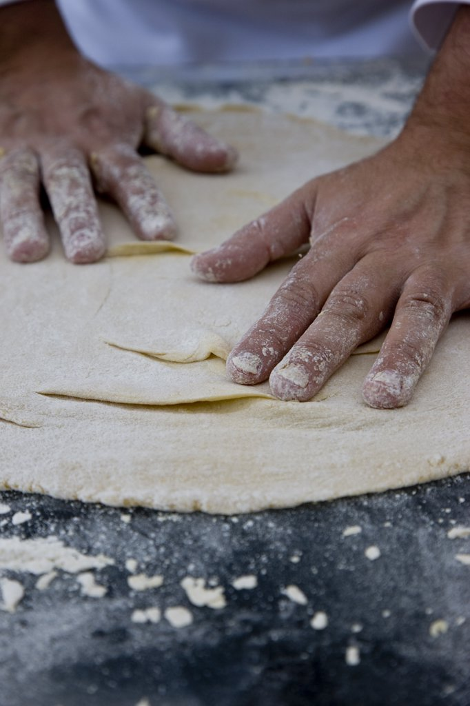 Stock Photo: 4278-4405 Close up of a chef hands covered in flour kneading a pizza dough