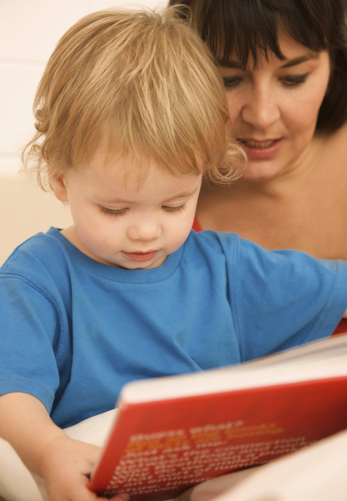 Stock Photo: 4278-4437 Woman with a child reading a bedtime story