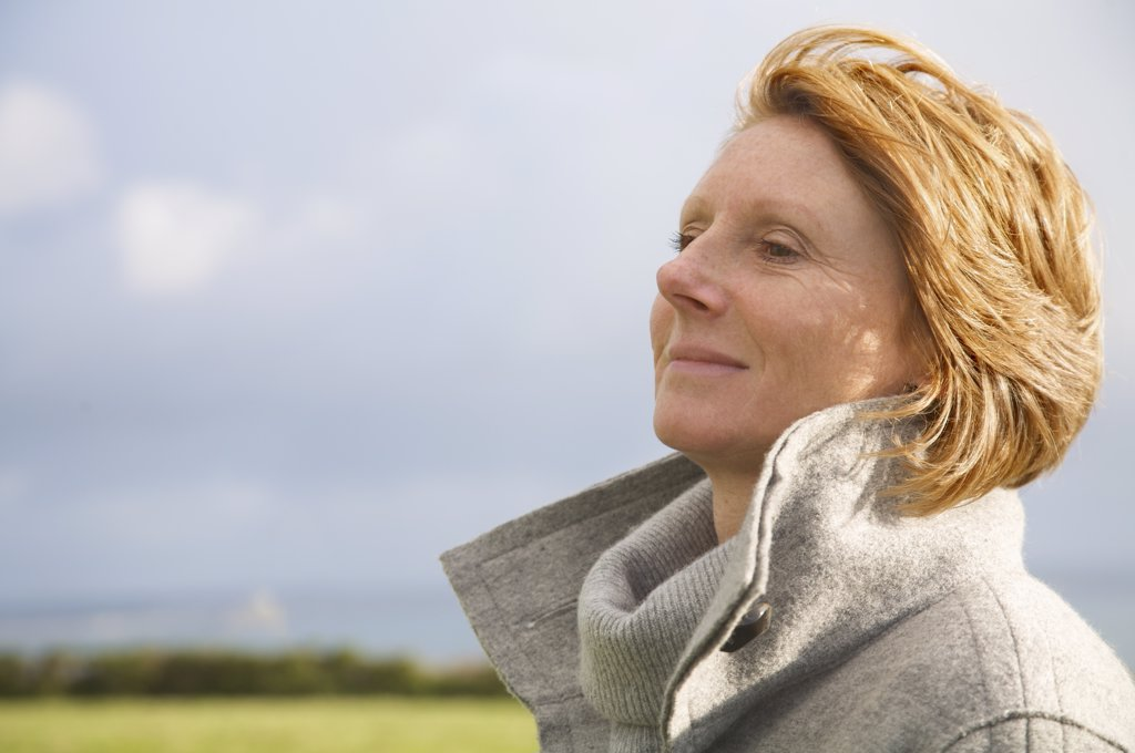 Stock Photo: 4278-4576 Woman looking into the distance smiling