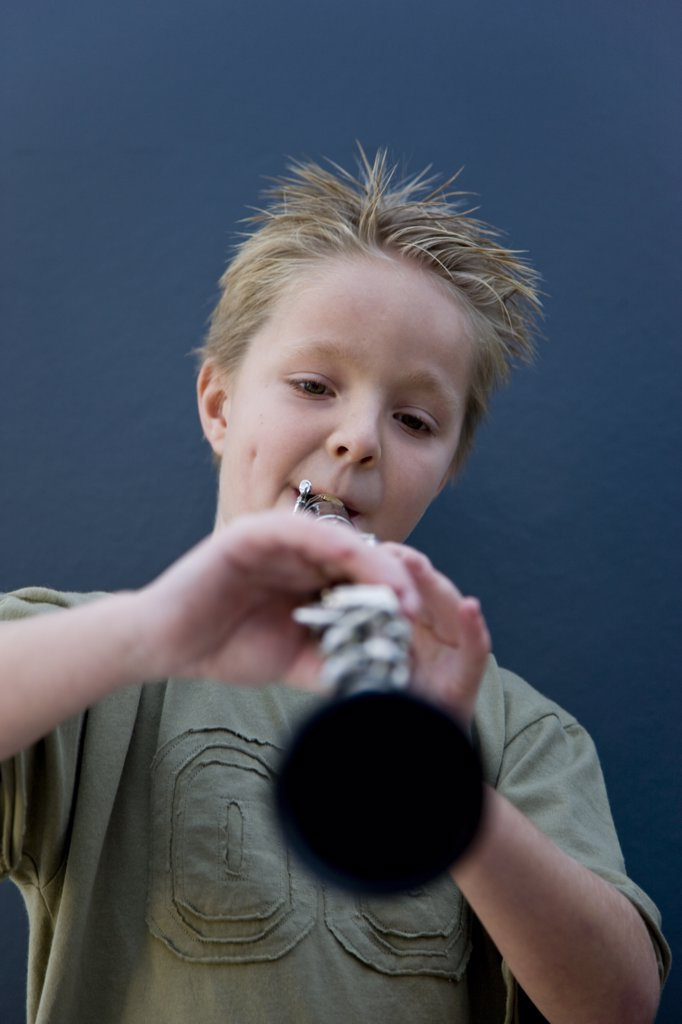 Stock Photo: 4278-4660 Boy playing the clarinet