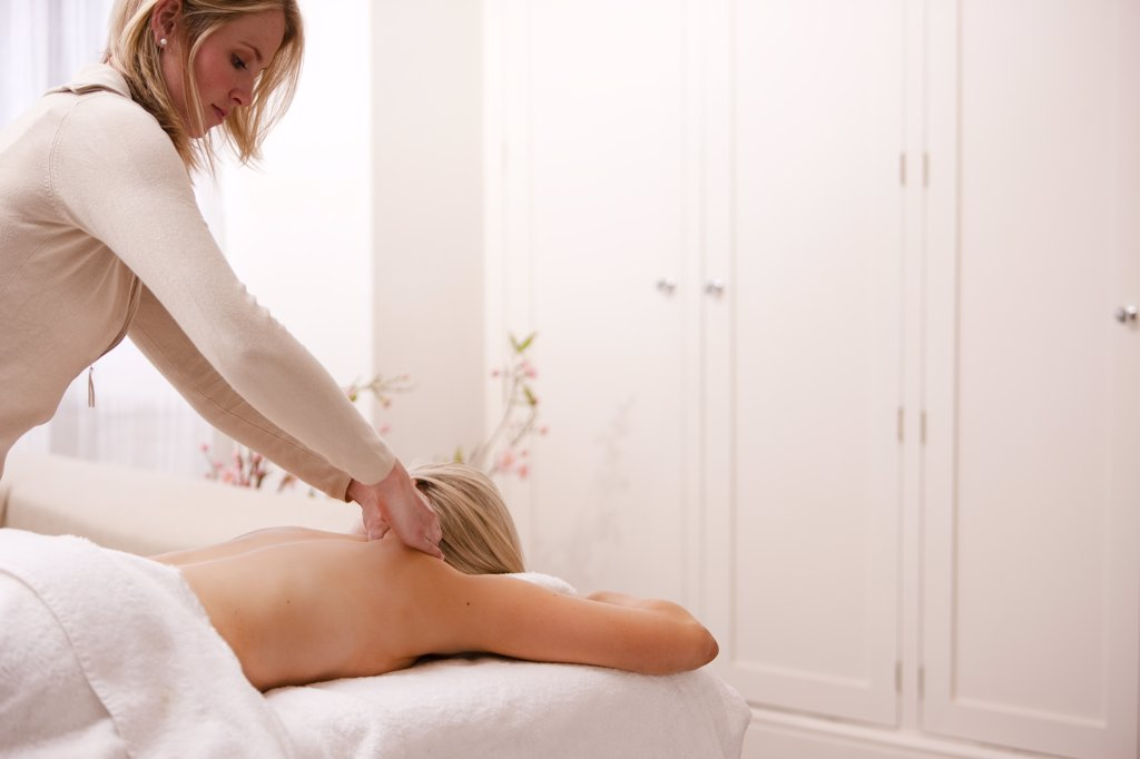 Stock Photo: 4278-5592 Masseuse giving a woman a back massage