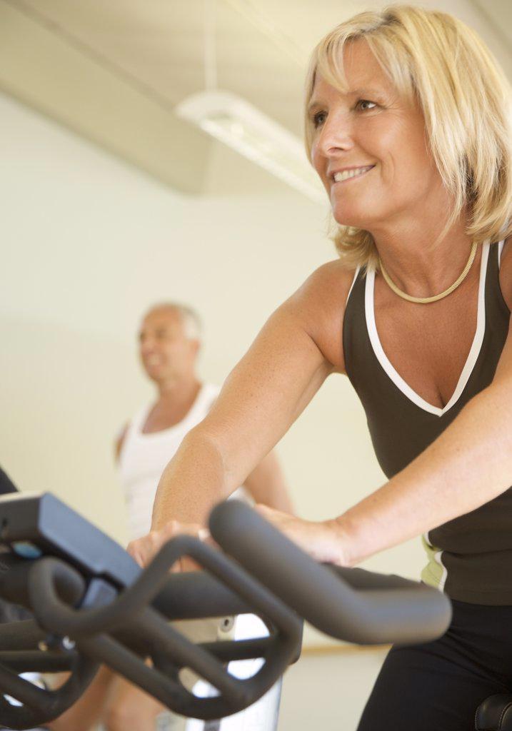 Stock Photo: 4278-5639 Woman on a gym bike