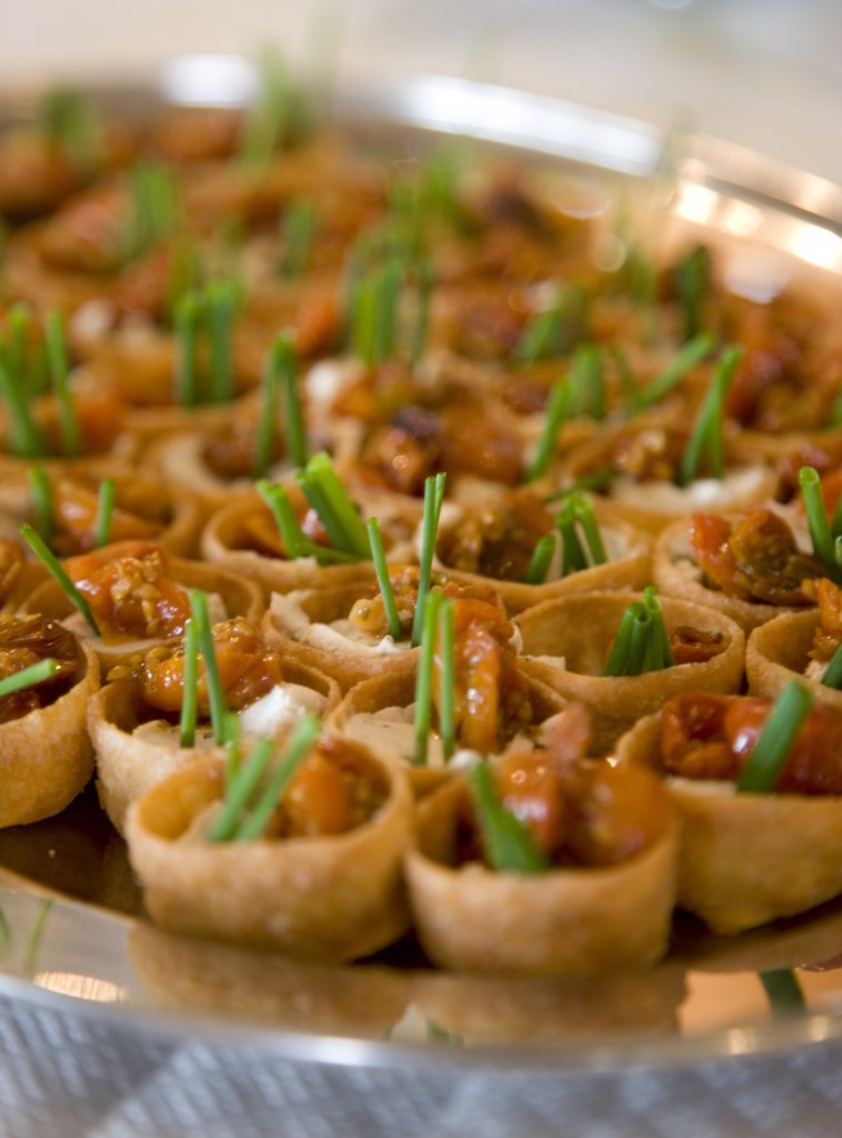 Close up of sun dried tomatoes and chives canapés : Stock Photo