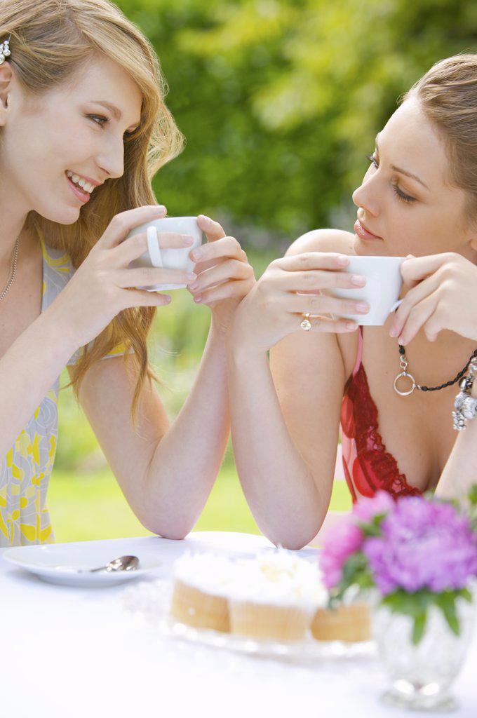 Two young women having coffee : Stock Photo