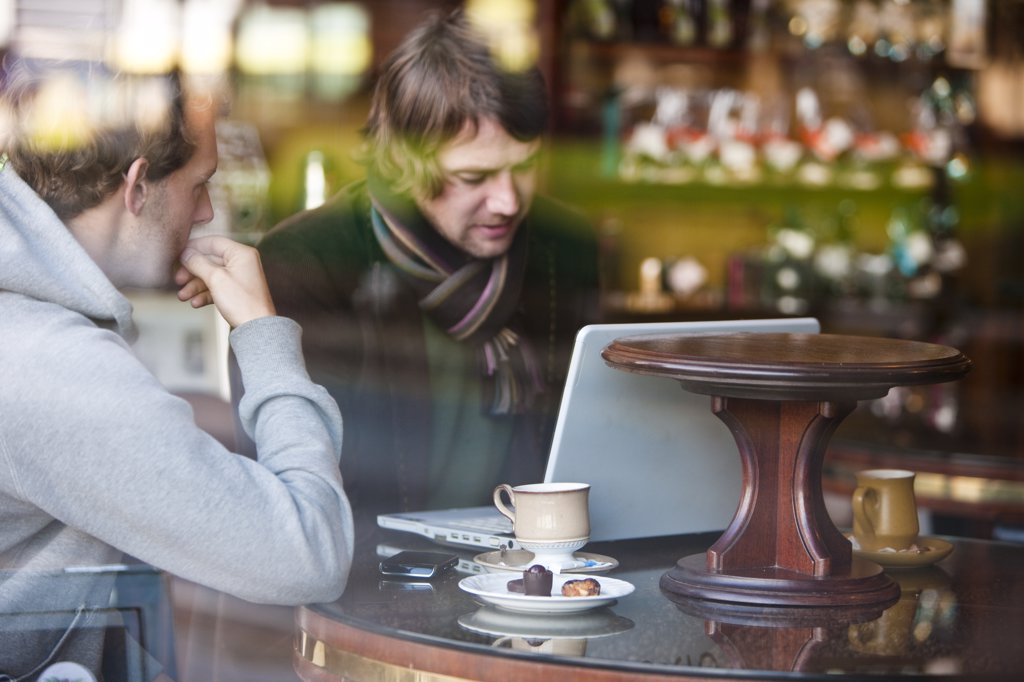 Stock Photo: 4278-6290 Two men talking in a cafe