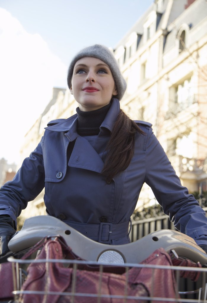 Stock Photo: 4278-6543 Young woman on a Velib