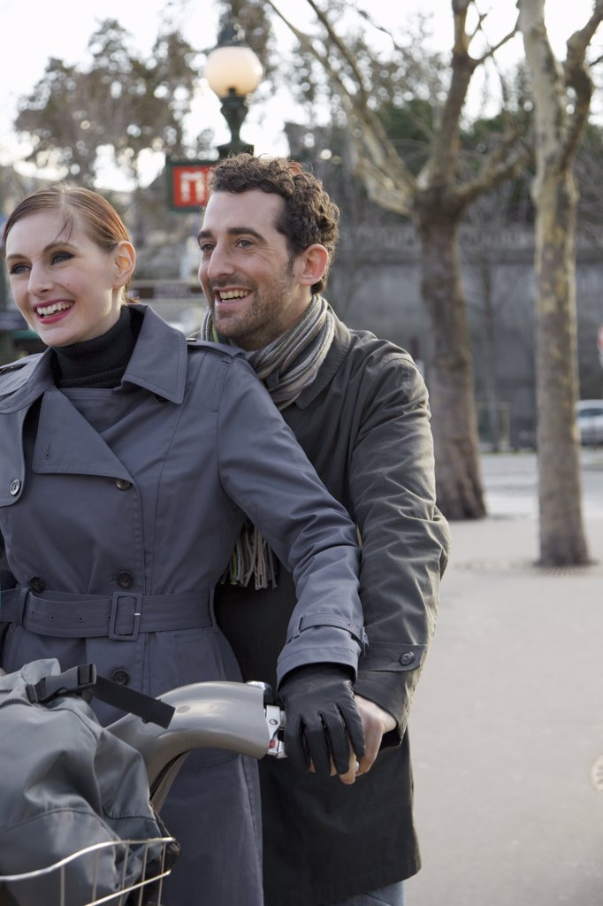 Stock Photo: 4278-6582 Close up of a couple on a Velib