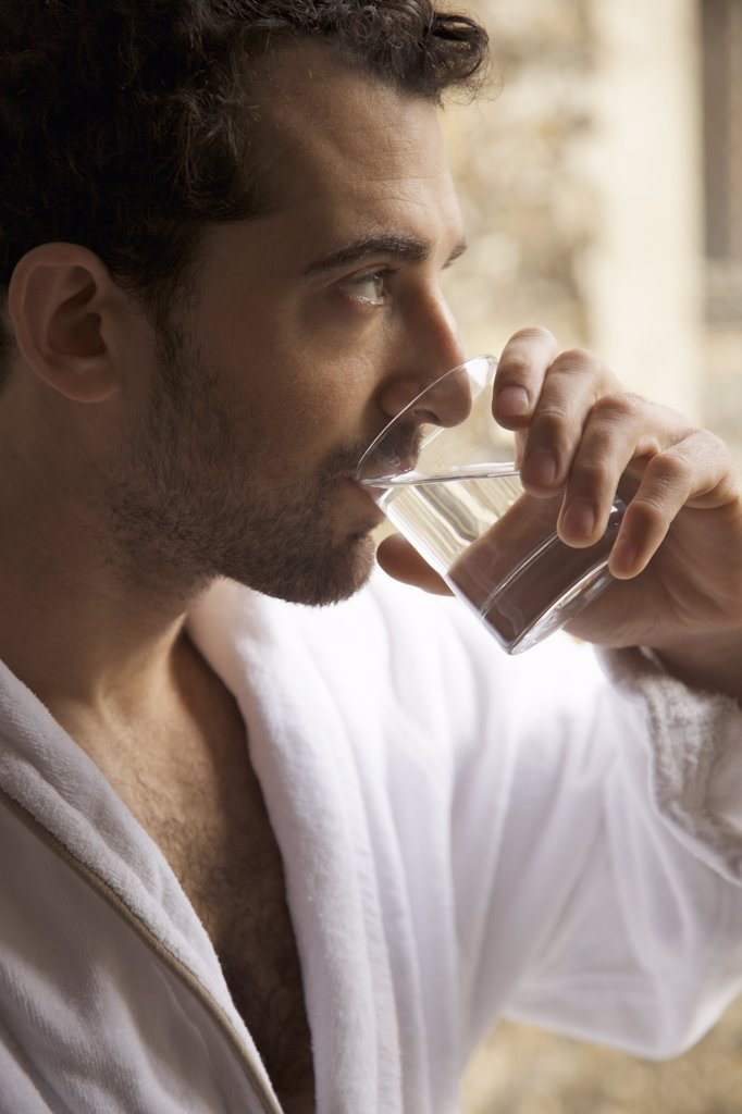 Close up profile of a man drinking water : Stock Photo