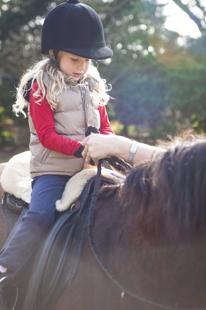 Stock Photo: 4278-6885 Young girl riding a horse