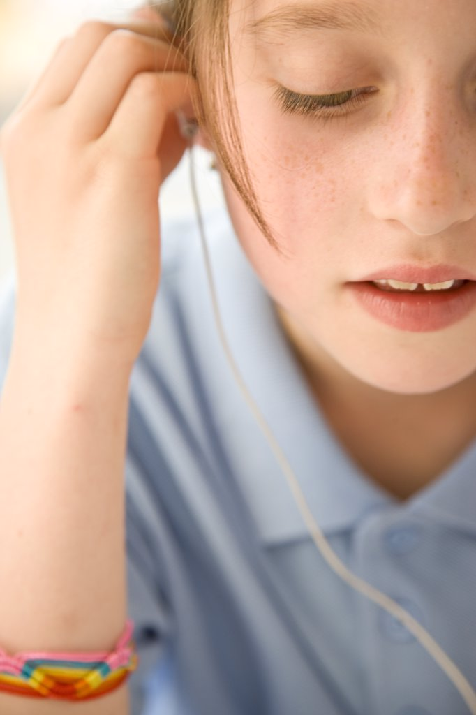 Stock Photo: 4278-7230 Girl Wearing Earphones