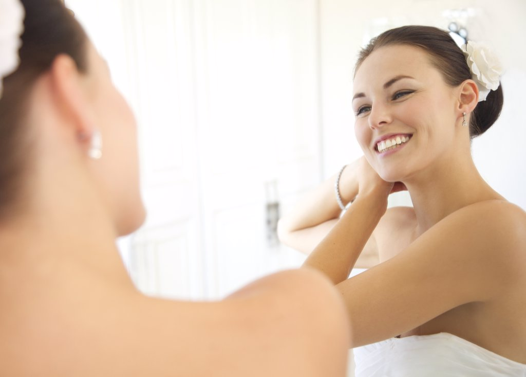 Stock Photo: 4278-7420 Mirror Image of Woman Adjusting Hair