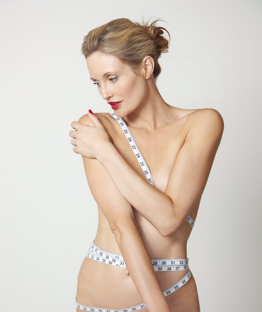 Stock Photo: 4278-7608 Nude Woman with Tape Measure Wrapped around Body