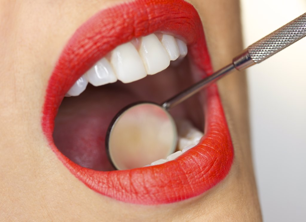 Close up of Woman's Mouth with Red Lipstick during Dental Examination : Stock Photo