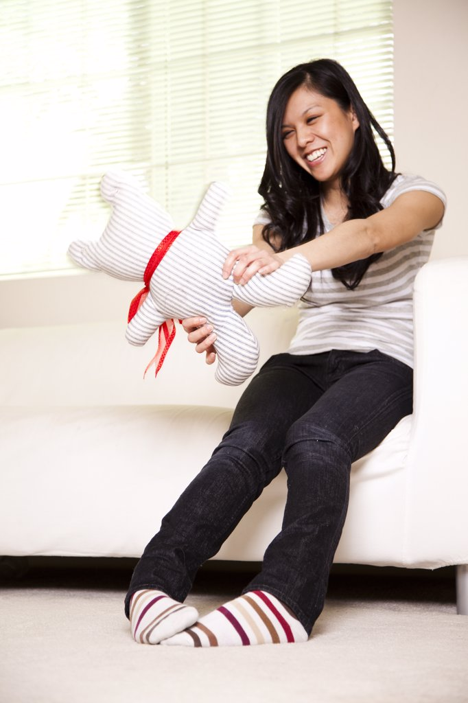 Teenage Girl Playing with Stuffed Toy : Stock Photo