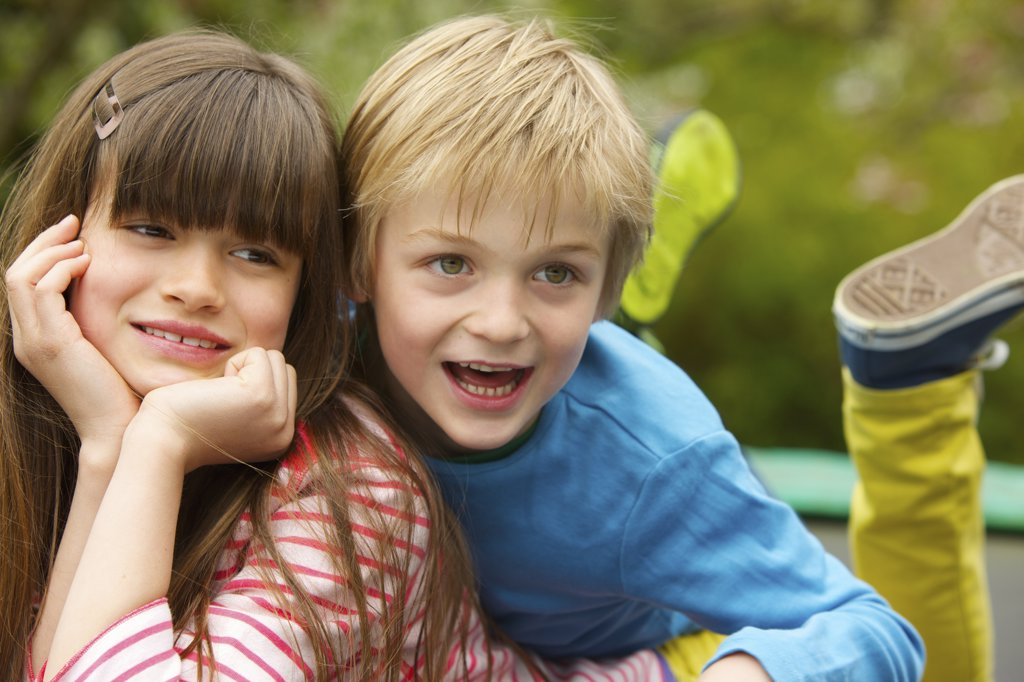 Stock Photo: 4278-8269 Boy and Girl Lying Outdoors