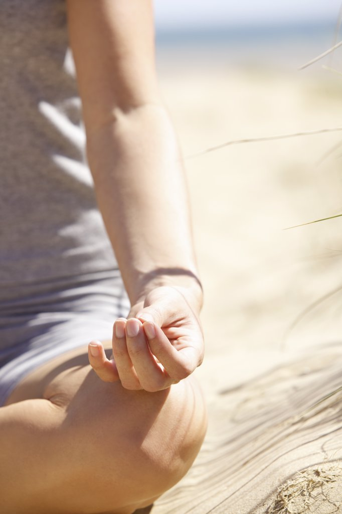 Stock Photo: 4278-8360 Woman's Hand Resting on Knee in Mudra Position