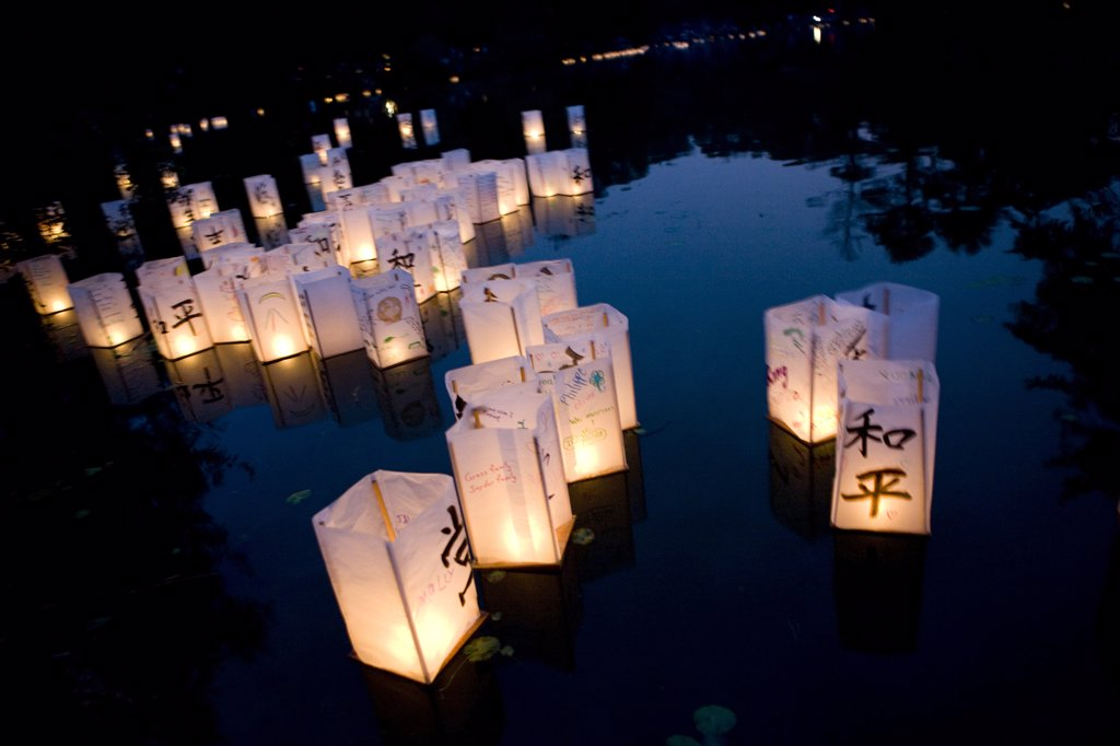 Prayer Paper Lanterns Floating on Water : Stock Photo