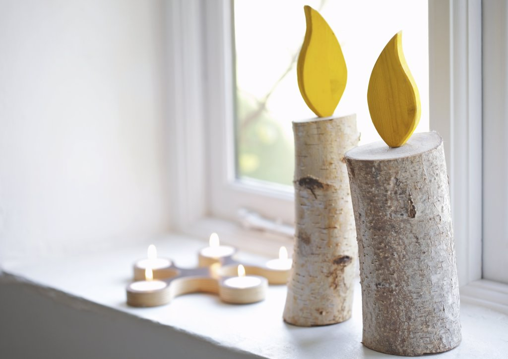 Stock Photo: 4278-8781 Handmade Decorative Candles on Window Sill