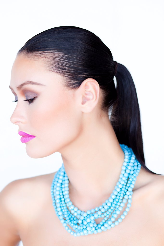 Stock Photo: 4278-9495 Woman Wearing Purple Lipstick and Turquoise Beads Necklace