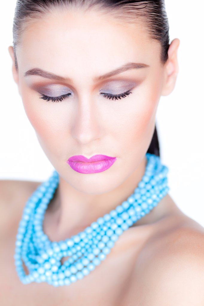 Stock Photo: 4278-9497 Woman Wearing Purple Lipstick and Turquoise Beads Necklace