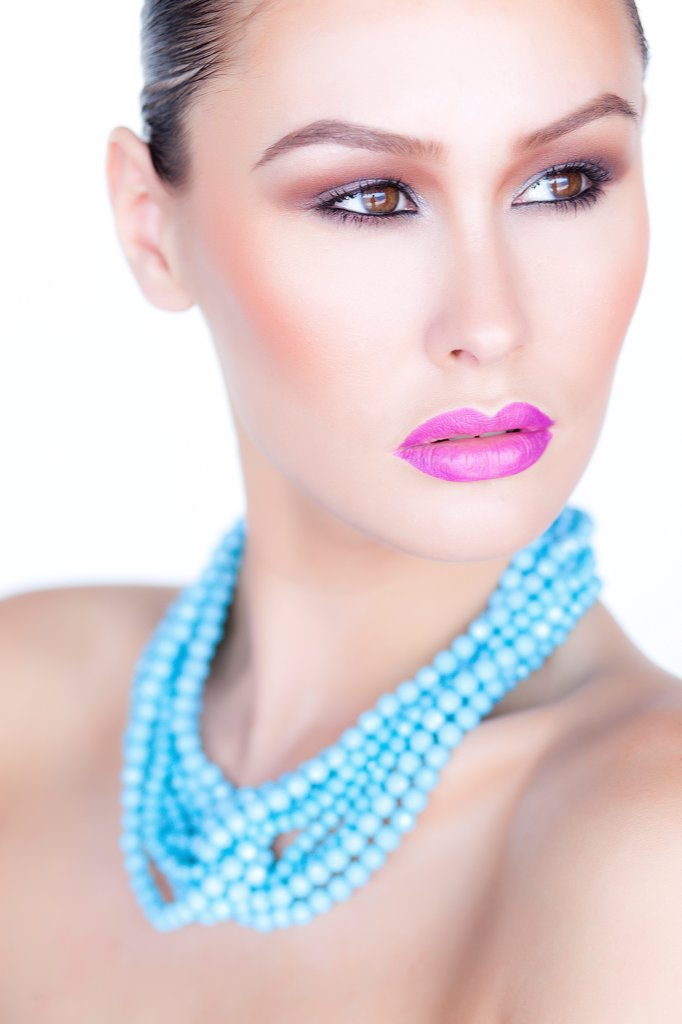 Woman Wearing Purple Lipstick and Turquoise Beads Necklace : Stock Photo