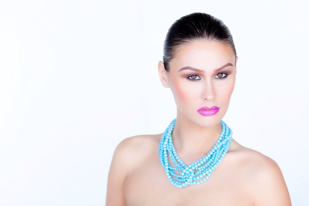 Stock Photo: 4278-9500 Woman Wearing Purple Lipstick and Turquoise Beads Necklace