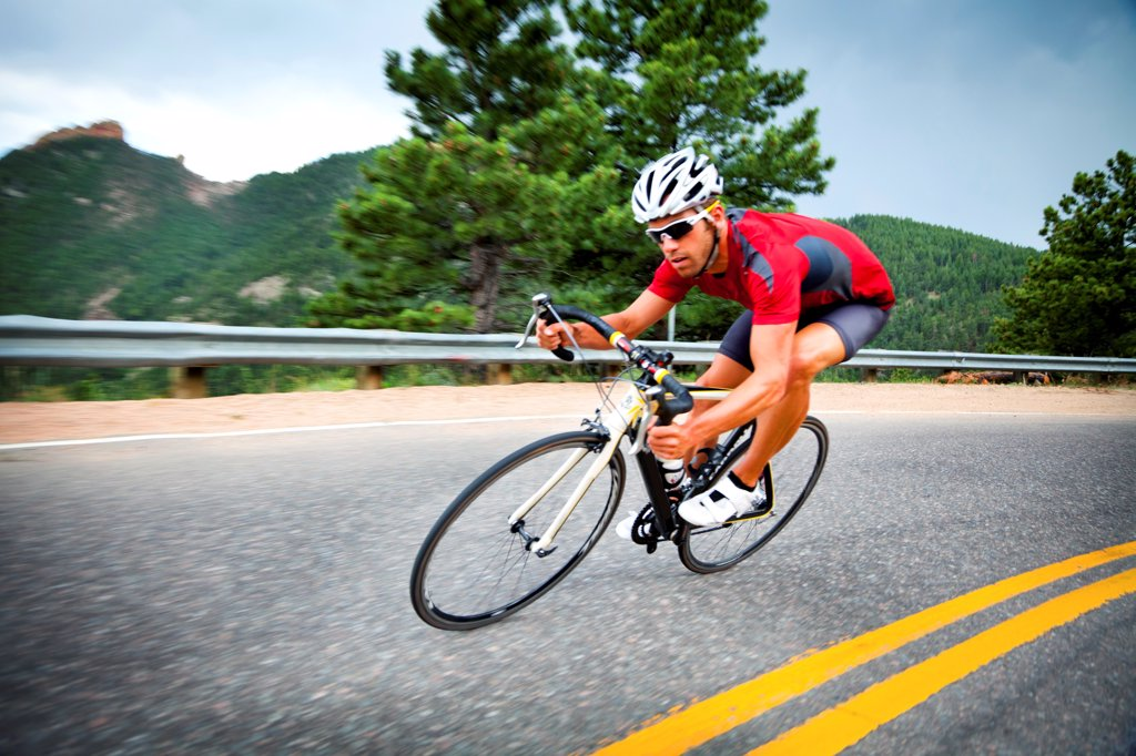 Stock Photo: 4278-9501 Cyclist Rounding a Bend