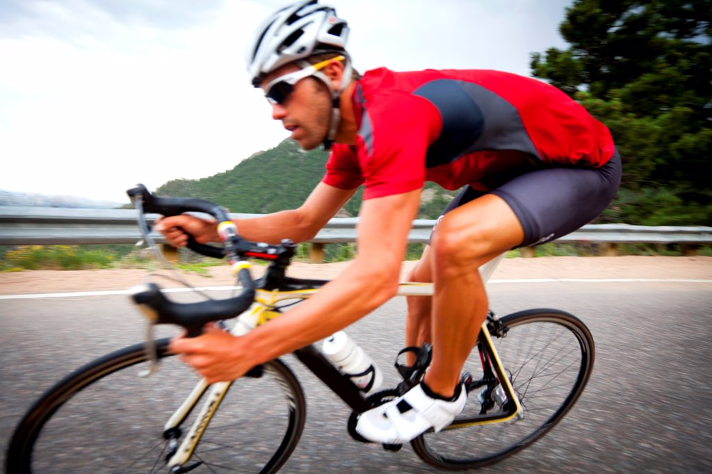 Stock Photo: 4278-9504 Cyclist Rounding a Bend
