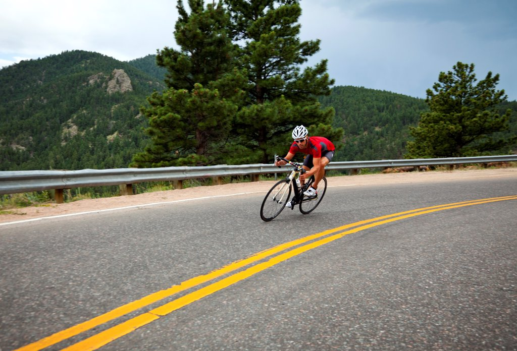 Stock Photo: 4278-9505 Cyclist Rounding a Bend