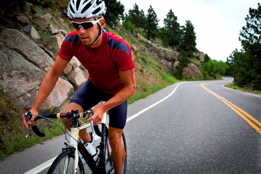 Stock Photo: 4278-9507 Cyclist Riding Bike on Road