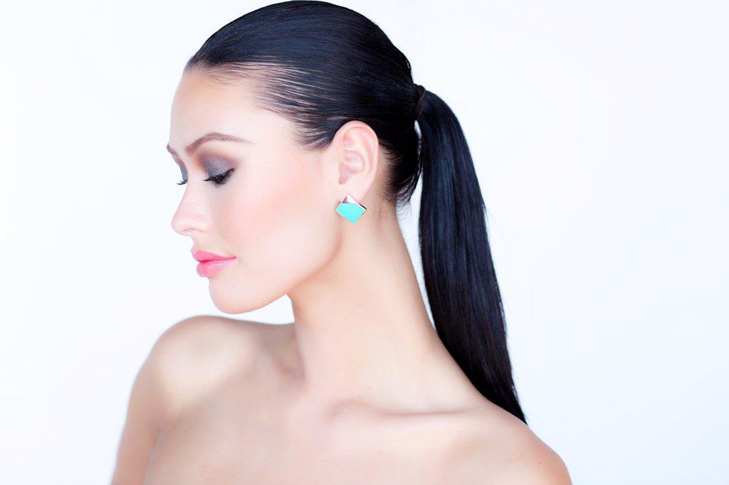 Portrait of Woman Wearing Gold Enamel Earring : Stock Photo