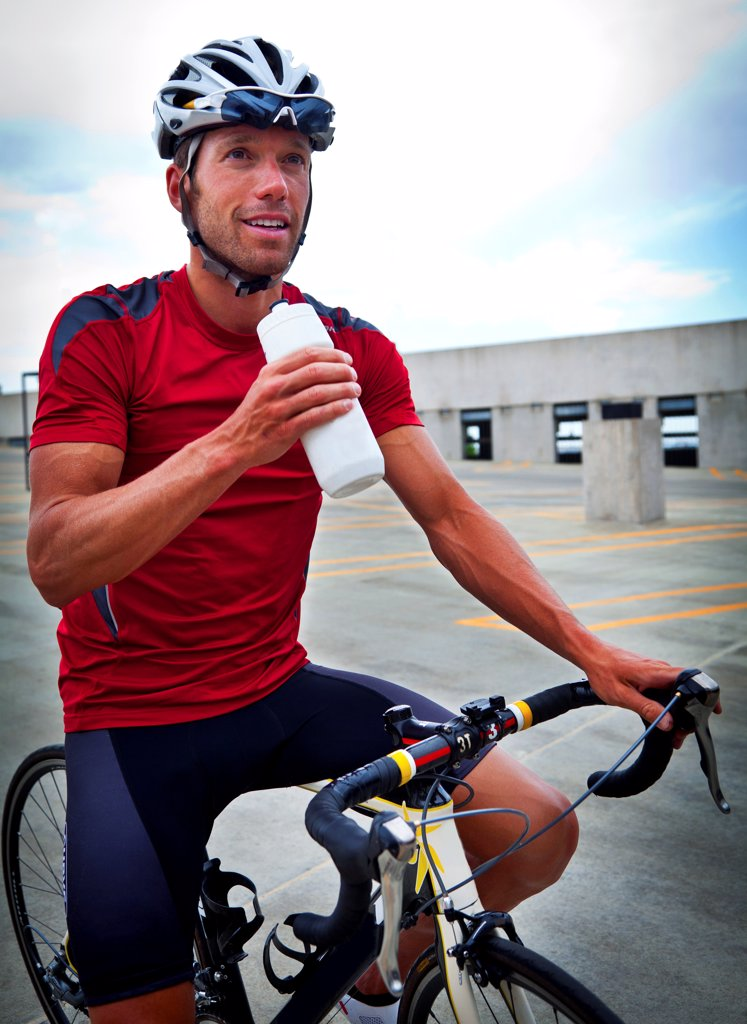 Cyclist Holding Water Bottle : Stock Photo