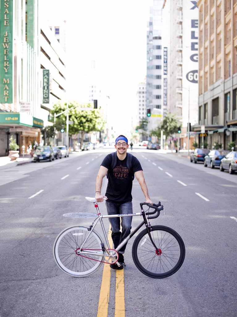 Man with Bicycle in City Road : Stock Photo