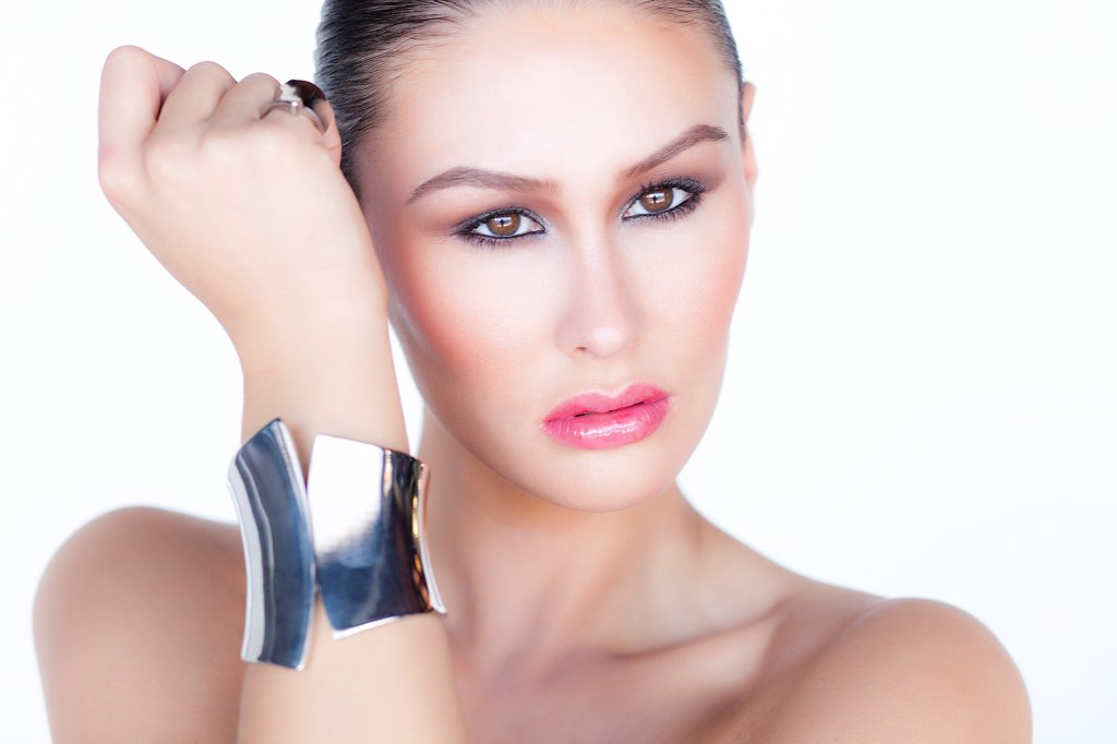Stock Photo: 4278-9526 Portrait of Woman Wearing Silver Cuff Jewel