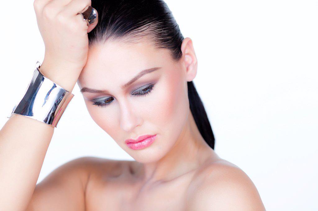 Stock Photo: 4278-9530 Portrait of Woman Wearing Silver Cuff Jewel