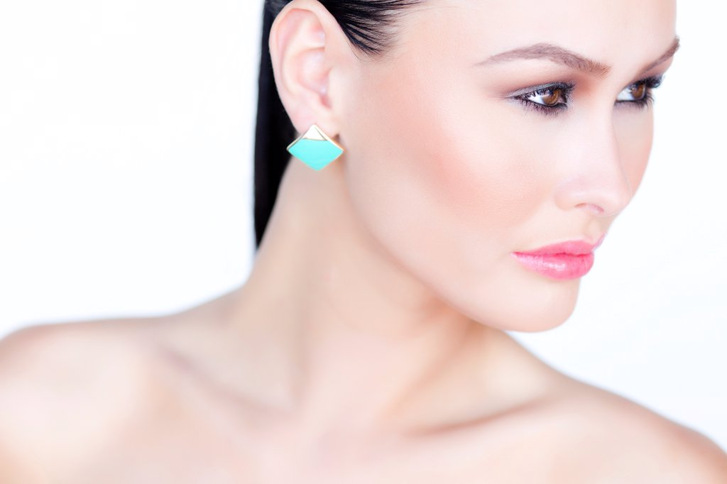 Portrait of Woman Wearing Gold Enamel Earring : Stock Photo