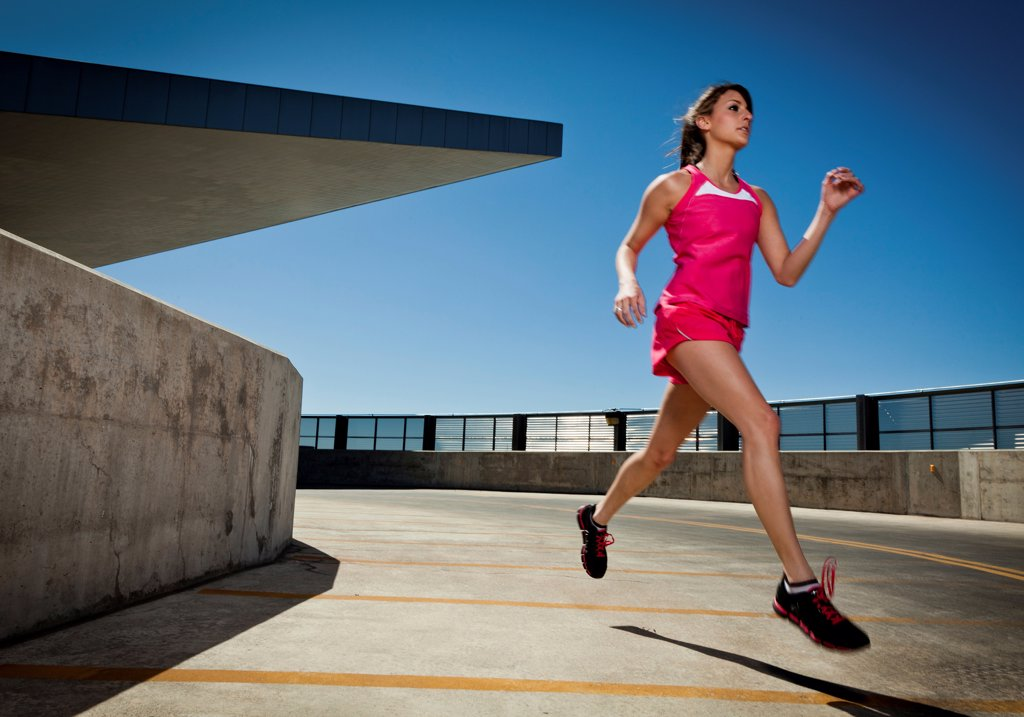 Stock Photo: 4278-9555 Young Woman Running Outdoors