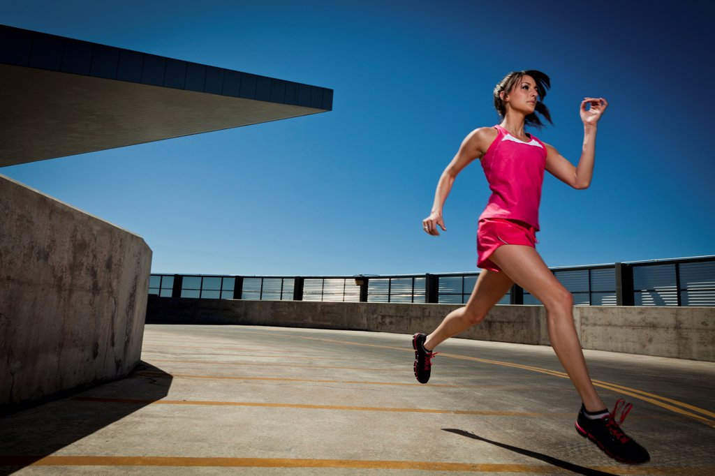 Stock Photo: 4278-9561 Young Woman Running Outdoors